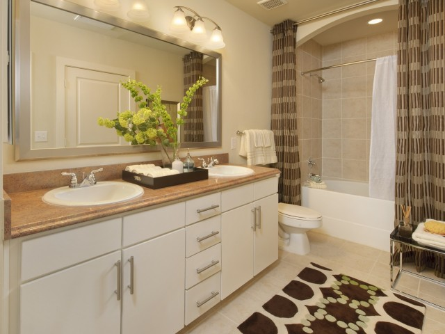 Image of Contemporary Tile in Bathroom for Voyager at Space Center Apartments