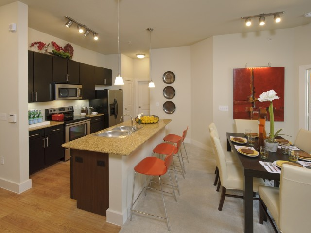 Image of Kitchen Islands with Pendant Lighting* for Voyager at Space Center Apartments