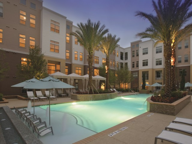 Image of Resort-style Pool with Sundeck, Cabanas and Heated Spa for Voyager at Space Center Apartments
