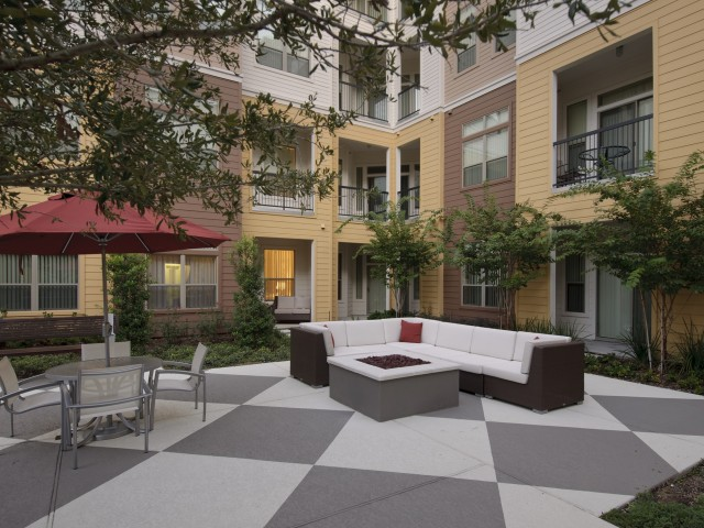 Image of Reflection Pond with Outdoor Fire Pit for Voyager at Space Center Apartments