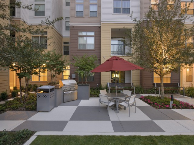 Image of Multiple Outdoor Grilling Areas for Voyager at Space Center Apartments