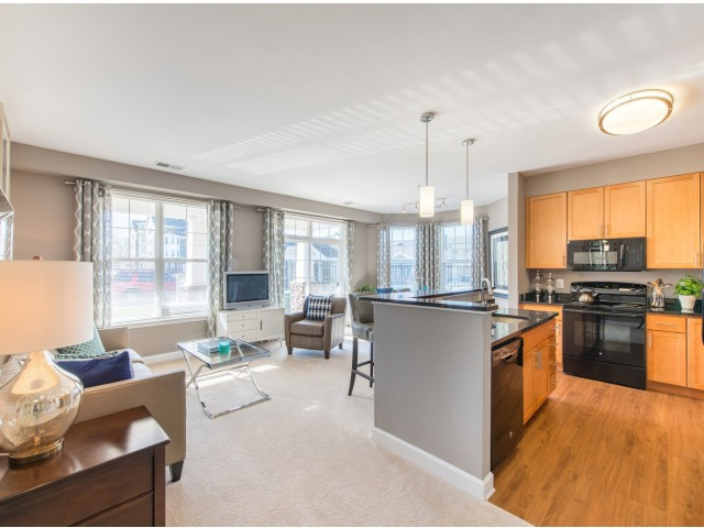 View of model apartment at Prospect Hall Apartments showing kitchen and living areas.