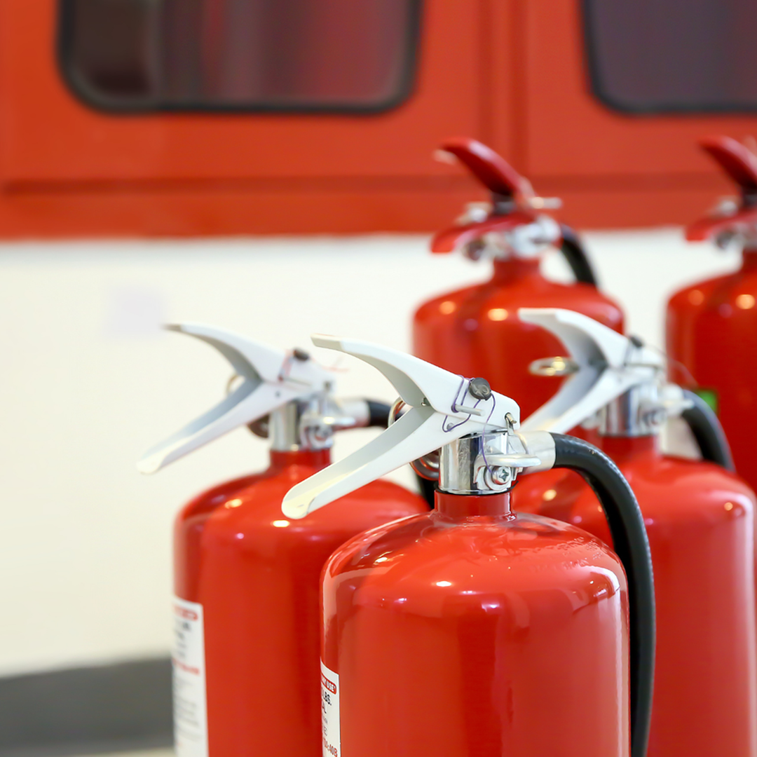 Set of five red fire extinguishers