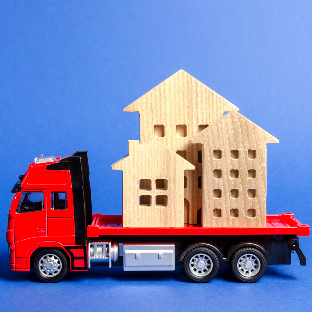 Toy moving truck moving a wooden toy house