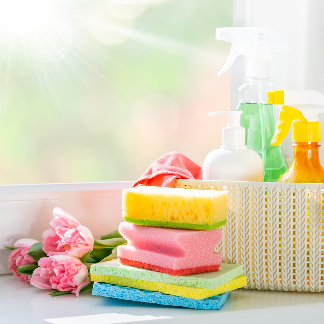 Spring Cleaning Supplies with Pink Roses and Sun Shining Through Window