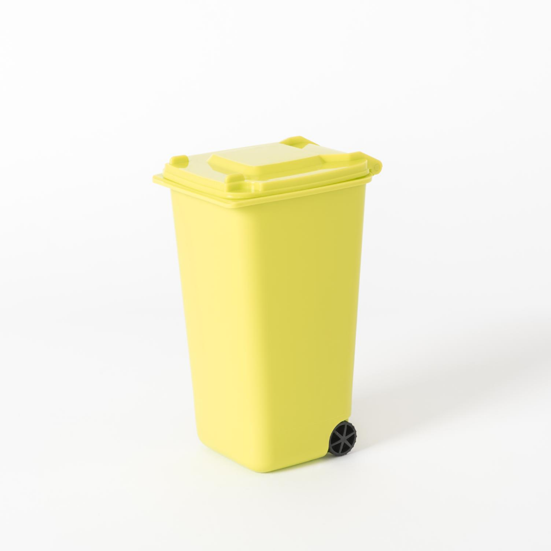 Yellow trash can on a white background.