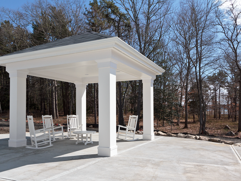 Image of Charming, private gazebo with comfortable outdoor furnishings for Little Neck Village