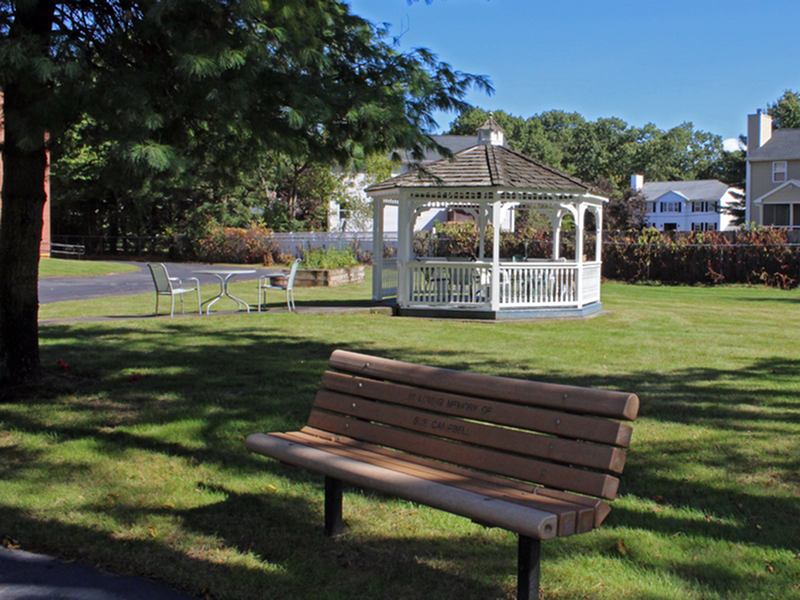 Image of Manicured grounds with benches and gazebo for Peter Sanborn