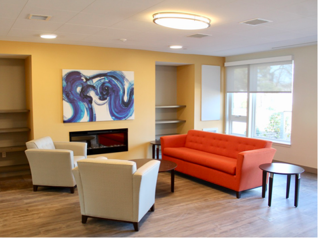 Image of Spacious central living area/lobby with fireplace and Wi-Fi for Harmon Apartments