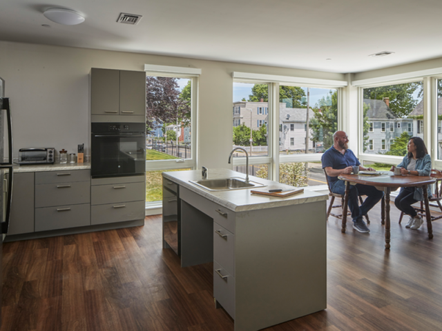 Image of Contemporary kitchen cabinets with accessible hardware and roll under access of sink and cooktop, front control range, wall oven and dishwasher for Harmon Apartments