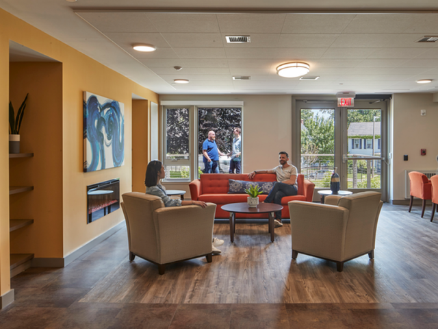 Image of Community lounge retreat with large screen TV for Harmon Apartments