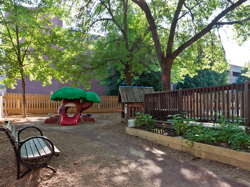 Private courtyard and fenced-in park area | Market Mill Apartments - Lowell, MA