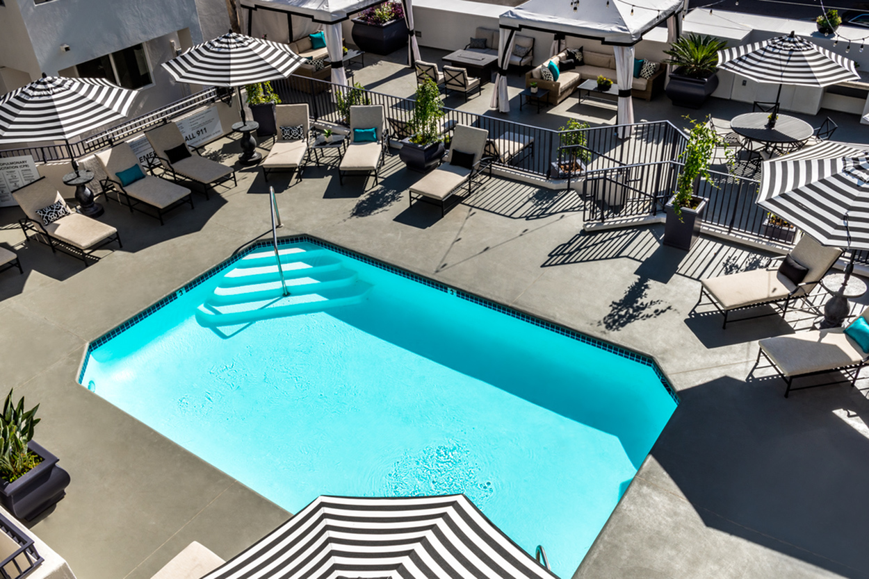 Image of Resort inspired pool and sun deck with cabanas, BBQ's, and fire pit for the ultimate in entertaining or relaxation for The Warwick