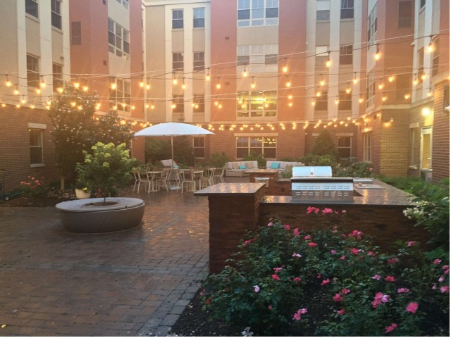Image of Courtyard with Outdoor Kitchen and Patio Seating for Twin River Commons
