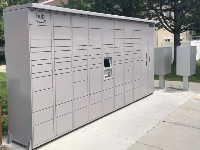 Photo of our community package lockers. Outdoor, accessible by code, open 24/7