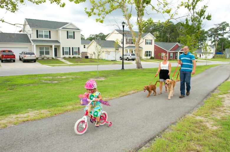 Walking Trail | Family Walking Dog | Military Housing Community