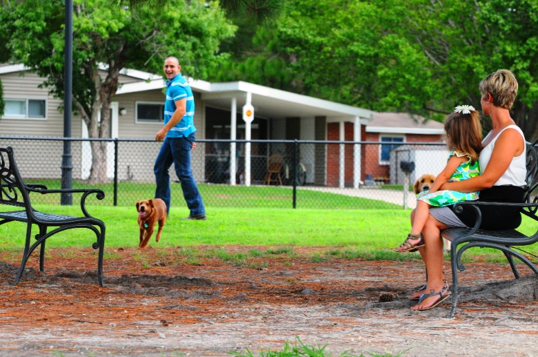 Pet Friendly Neighborhood | Park Bench | Family Playing Outside