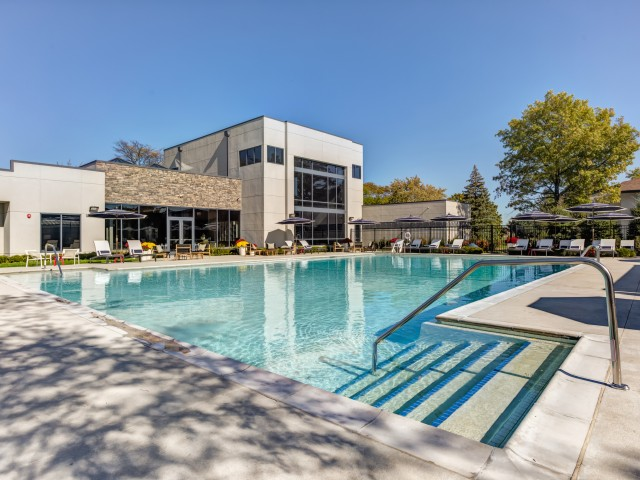 Image of Resort Style Heated Pool Surrounded by Relaxing Chaise Furnishings for Residences at Arlington Heights
