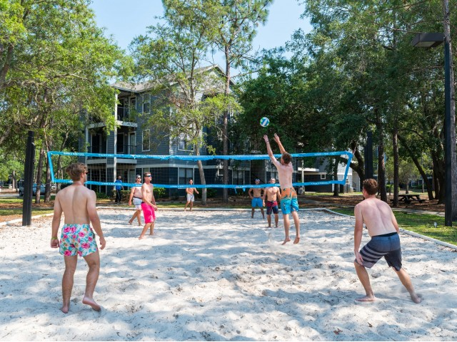 UNF Student Apartments Exterior | Volleyball net | Beack volleyball | Guys playing