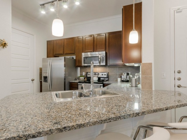 Image of Elegant Granite Kitchen & Bath Countertops for The Grand Estates in the Forest