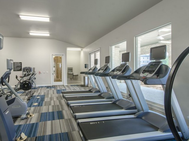 Image of 24/7 Fully Equipped High-Tech Fitness Center with Cardio Theater, Free Weights & Training Stations for The Mansions Woodland