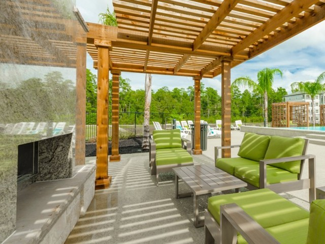 Image of Trellis-Covered Outdoor Kitchen & Conversational Fireplace Lounge for The Mansions Woodland