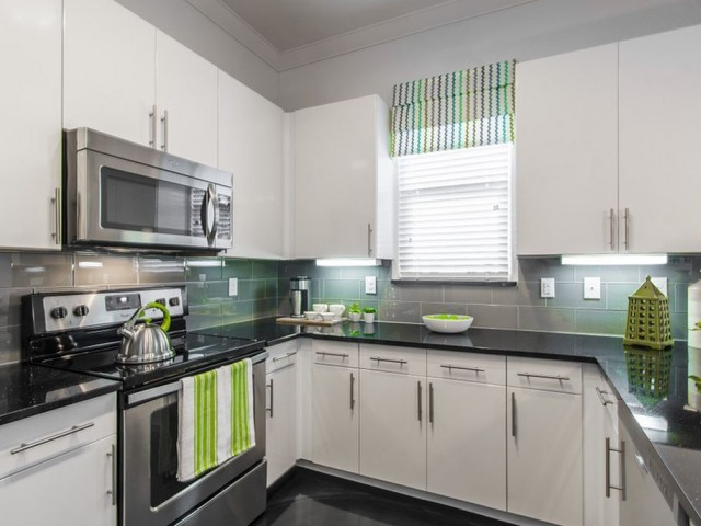 Image of Oversized Custom Kitchen Cabinets & Modern Glass Tile Backsplashes for The Towers Seabrook