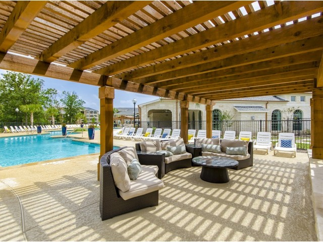 Image of Trellis Covered Outdoor Kitchen and Conversational Fireplace Lounge for The Mansions on the Park