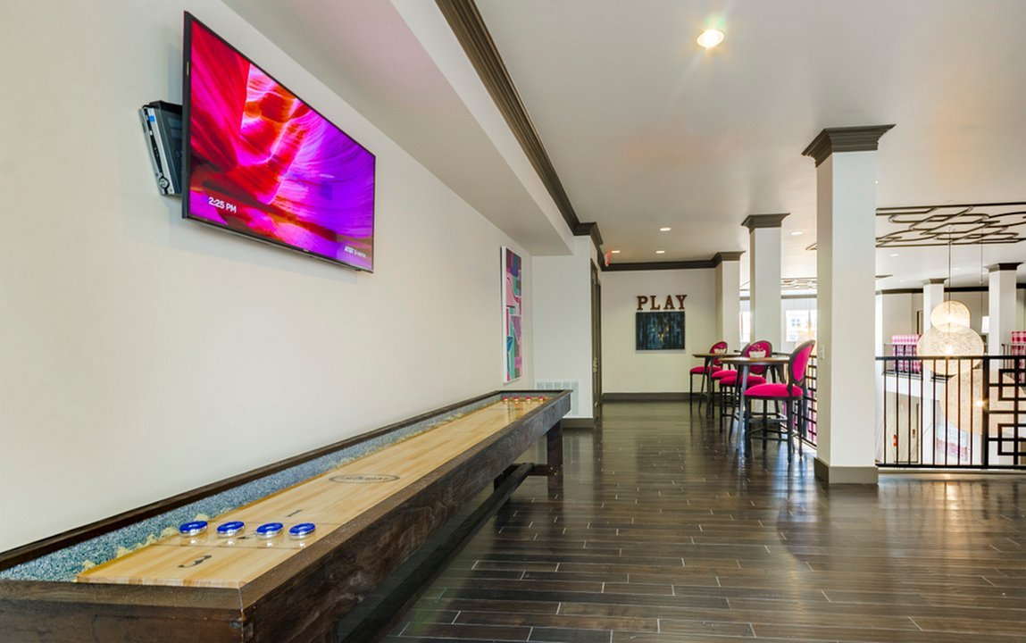 Image of Mezzanine eLounge with HDTV,  Shuffleboard, WiFi & Computer Lab for The Mansions McKinney