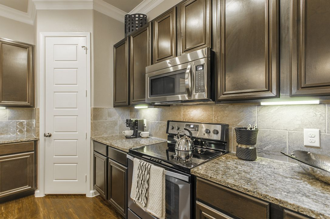 Image of Oversized Designer Kitchen Cabinets with Whirlpool® Stainless Steel or Black-on-Black Kitchen Appliances for The Mansions at Briggs Ranch