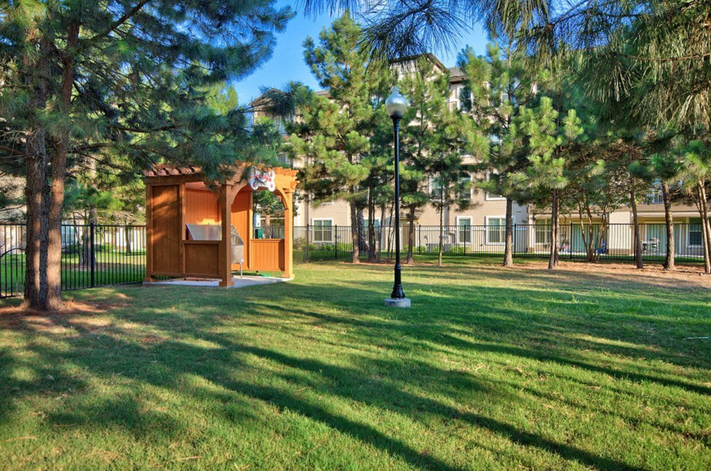 Image of Pet-Friendly Community with Convenient Waste Stations for The Grand Estates Woodland