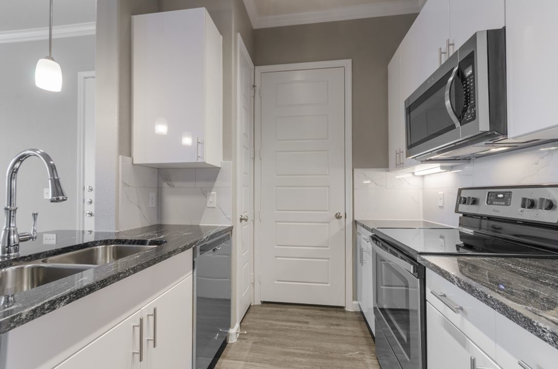Image of Designer Kitchen Cabinets with Modern Stainless Steel Whirlpool® Appliances for The Mansions at Spring Creek