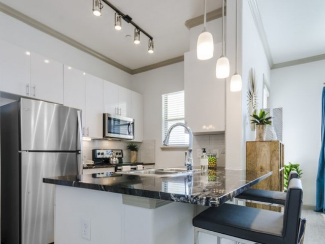Image of Contemporary Track Lighting  &  Designer Pendants for The Mansions at Spring Creek
