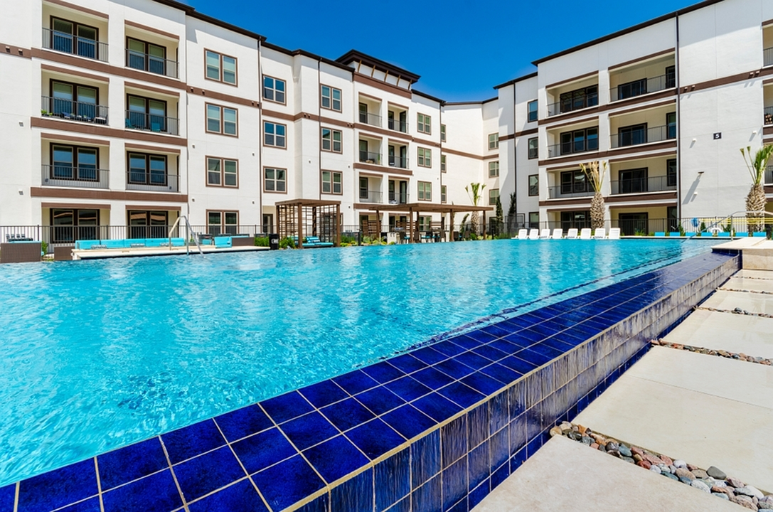 Image of Infinity-Edge Olympic-Size Swimming Pool with Tanning Deck & Private Cabanas for The Towers at Spring Creek