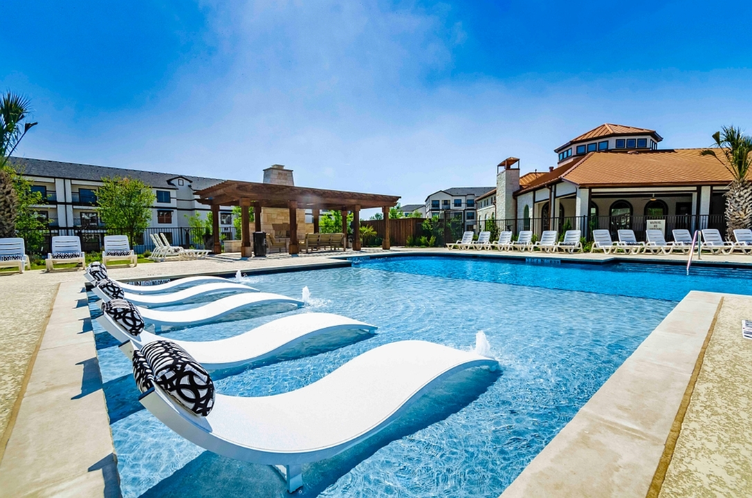 Image of Luxe, Resort-Style Swimming Pool with Tanning Deck for The Mansions at Spring Creek