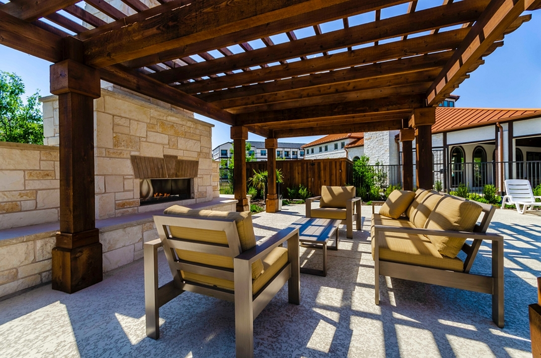 Image of Trellis-Covered Outdoor Entertainment Kitchen & Conversational Fireplace Lounge for The Mansions at Spring Creek