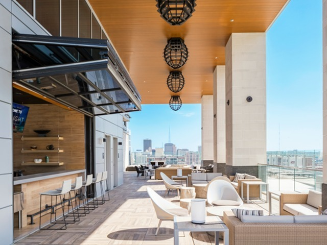 Image of Full-Service Indoor-Outdoor Bar for Two Light Luxury Apartments
