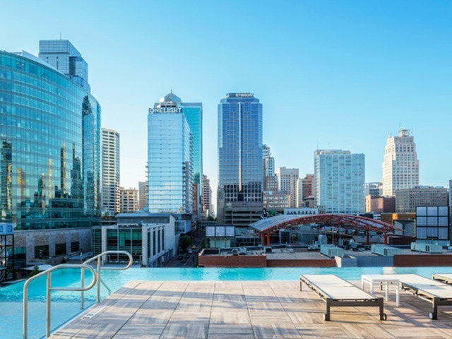 Image of Infinity Edge Rooftop Pool with Skyline Views for Two Light Luxury Apartments