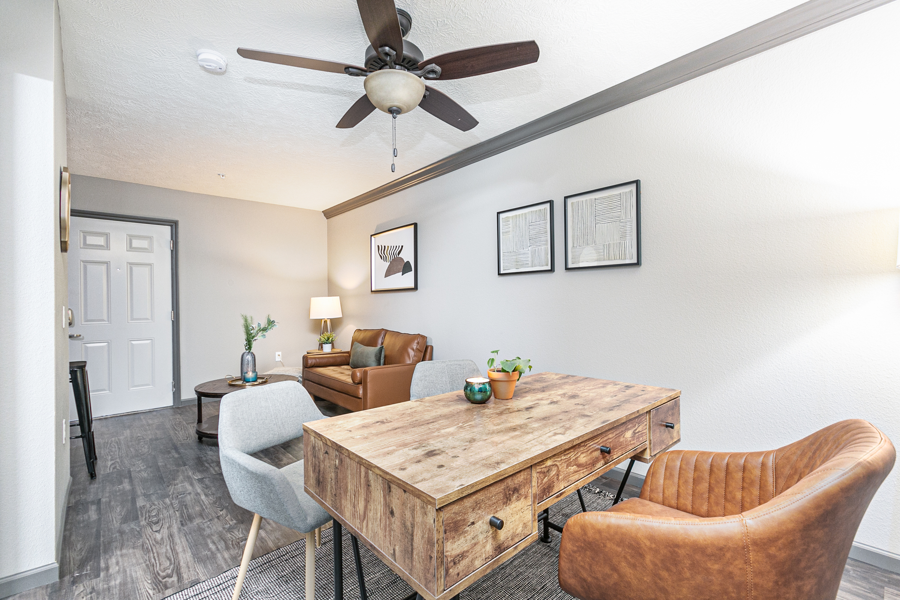 studio apartment with a desk and a living room couch and coffee table