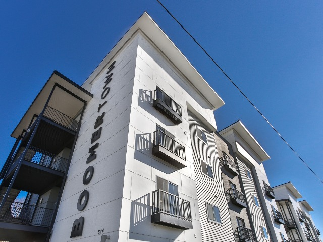 white building with black juliet balconies