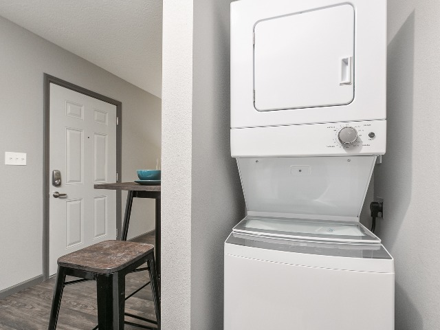 stackable washer and dryer in a furnished studio apartment at Northgate