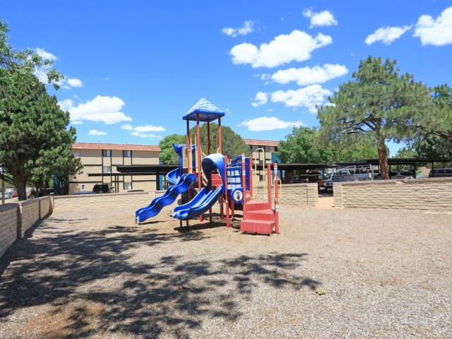 Outdoor all-in-one style playground featuring 3 slides, stairs and various obstacles. This playground is an amentiy at Monterra Apartment Homes.