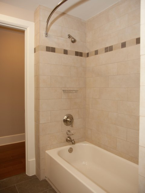 Image of Gorgeous Showers with Curved Rods for Hibernia Tower