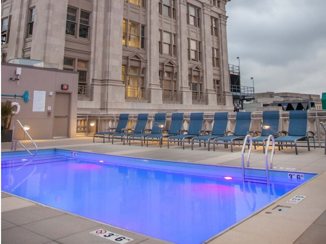 Image of Spectacular Rooftop Amenity Deck with Panoramic City Views.  Featuring Our Large Swimming Pool with Color Changing Light Element, Ample Dining and Lounge Areas, and Barbecue Grilling Stations. for Hibernia Tower