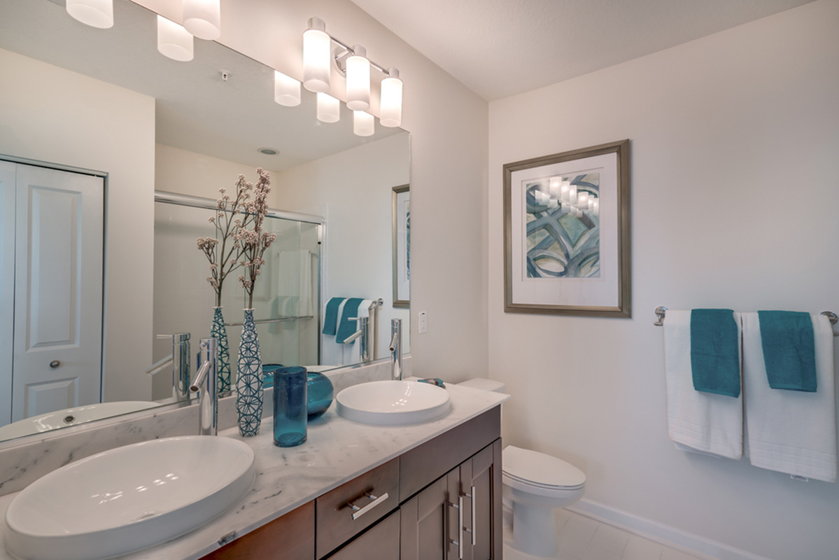 View of Bathroom, Showing Vanity Double Sinks, Toilet, and Walk-In Shower at The Marq Highland Park Apartments