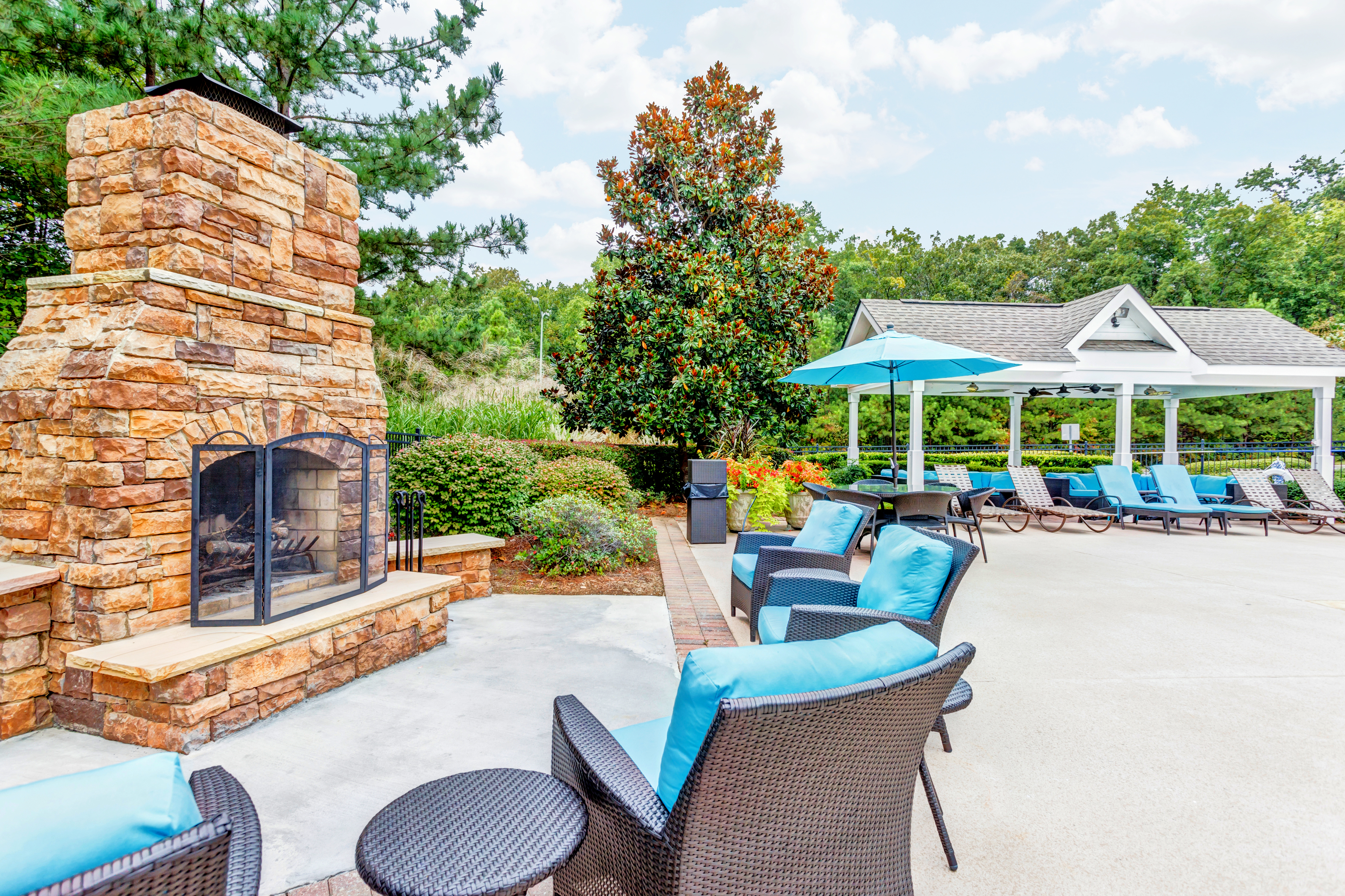 View of Pool Area, Showing Fireplace, Outdoor Furniture, and Cabana at Summer Park Apartments