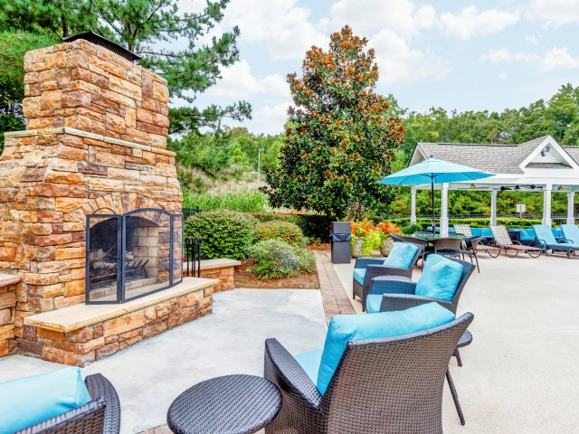 Image of Outdoor Lounge with Fireplace for Summer Park