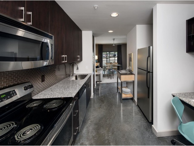 Image of Cottonwood Westside apartment kitchen with stainless steel appliances and built-in desk