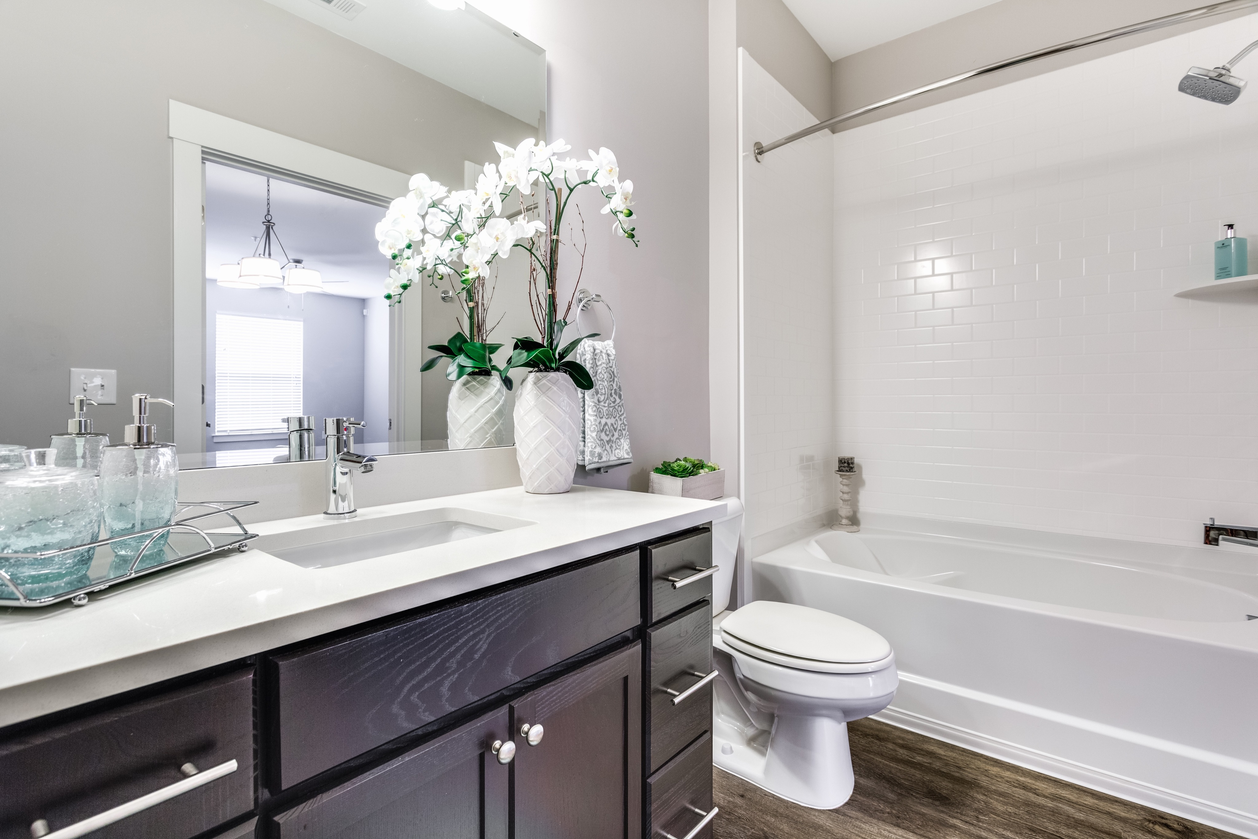 View of Renovated Apartment Interiors, Showing Bathroom With Garden Tub, Plank Flooring, and Single Vanity at Cottonwood Reserve Apartments