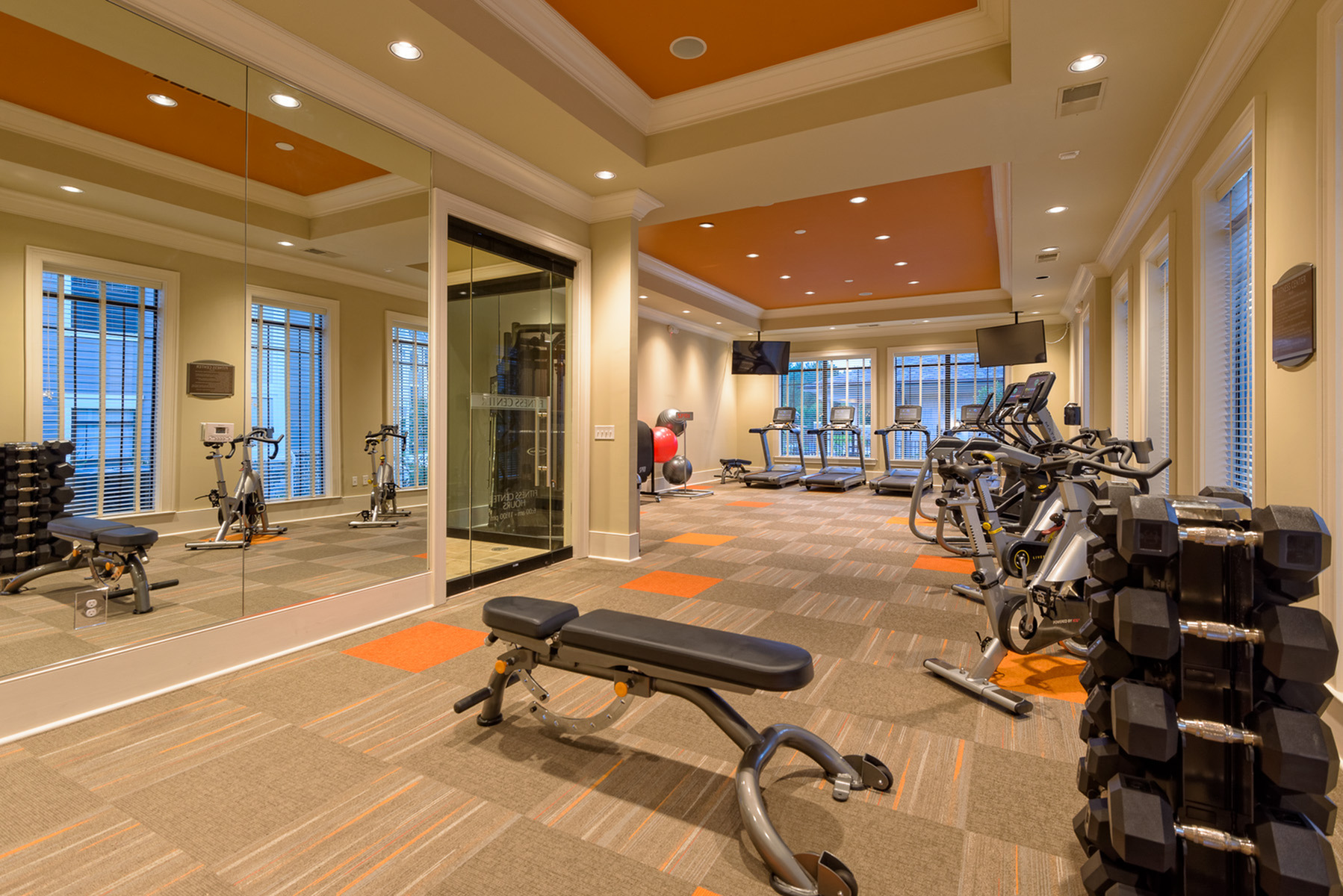 View of Fitness Center, Showing Free Weights, Bench, and Cardio Machines at Heights at Meridian Apartments
